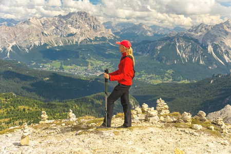 Sporty Young woman on mountain trail Dolomites Mountains, Italy. Sport, success, inspiration