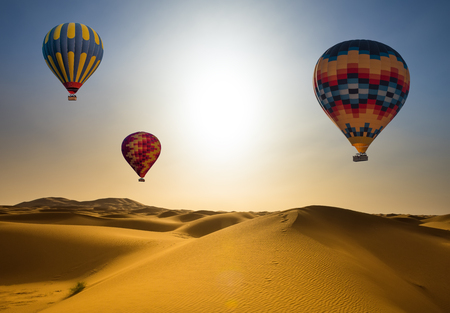 Desert and hot air balloon Landscape at Sunrise.