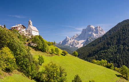 Beautiful summer landscape and view of little church Chiesa di Santa Lucia Dolomites, Italy. Stock Photo