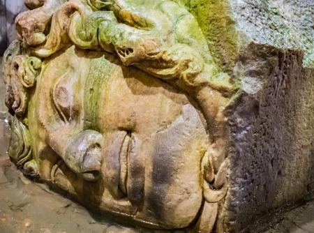 The Column with inverted Medusa head base in Basilica Cistern. Istanbul. Turkey
