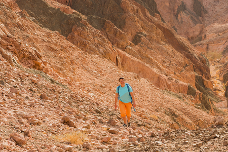 Woman mountain Hiker with backpack enjoy view in Sinai desert Reklamní fotografie