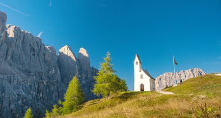 Chapel with mountain view in background, Passo Gardena, Dolomite Mountains, Italy Stock Photo