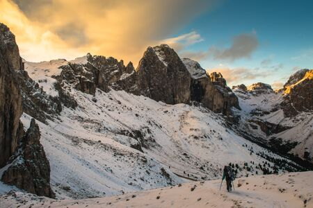 One middle aged woman hiking in mountains, Dolomites Italy