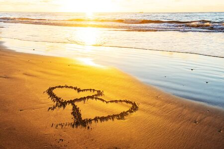 Couple hearts on sea beach. Valentine day and love concept Stock Photo