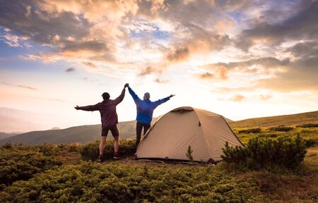 Camping and active couple on the top of high mountains. Success, Achievement, Active life style. Tatras, Zakopane, Poland