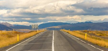 Iceland road landscape. Clouds and ocean on the horizon. Famous tourist attraction