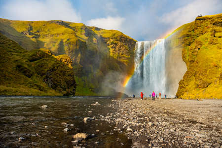 Skogafoss waterfall and rainbow at sunny autumn day, Iceland. Great tourist attraction,