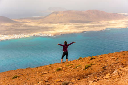 Tourist girl looking from Mirador del Rio, Lanzarote, Canary Islands