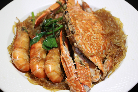 Shrimps roasted and crab with vermicelli in white plate, Thai food, Thailand