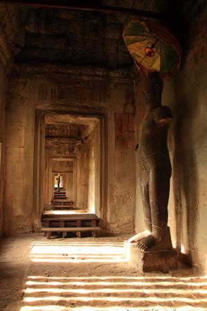aisles: Buddha statues inside aisles Angkor Wat.