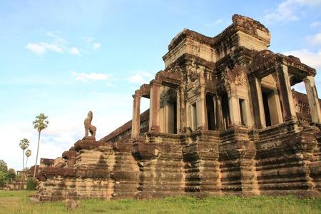 Buddha statues inside aisles Angkor Wat.