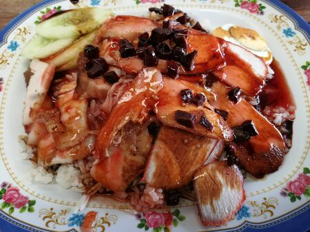 Pork with red rice is a popular food in Thailand. Imagens - 130205754