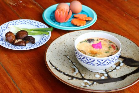 Shiitake poached eggs are a popular food eaten in Thailand. Imagens - 131878875