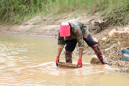 Villagers surveying gold ore on the banks of the Mekong River in Pak Chom District, Loei Province, on 31 August 2019 Editorial
