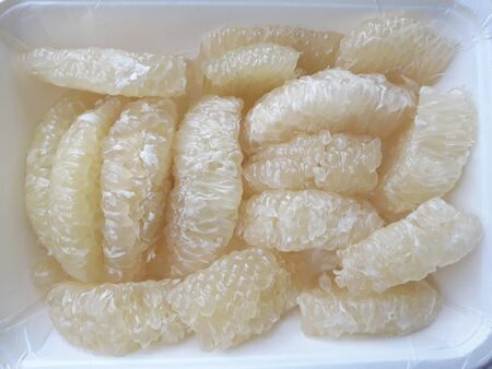 Pomelo is a popular fruit grown and eaten in Thailand.