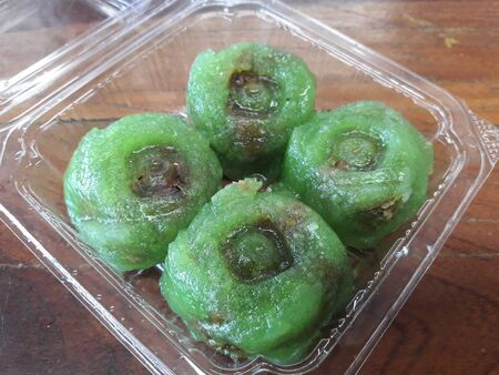 The transparent balls are called Saku Sai Moo or Steamed Tapioca Dumplings with Pork