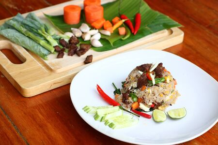 Sweet pork fried rice is a popular food in Thailand. Imagens