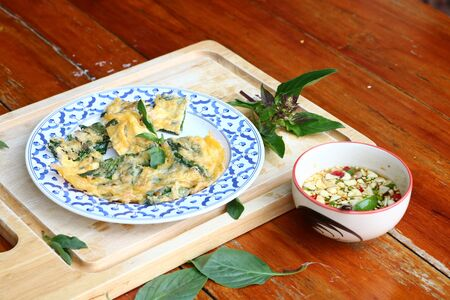 Basil fried eggs Is a local food of Isan in Thailand. Imagens