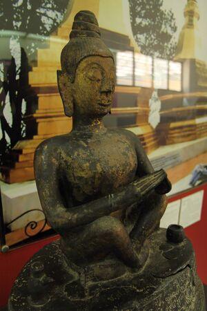 Buddha Subduring Mara. Lan-na Art 14-16  centuries A.D. from Wat Pong Sanuk, Chiang Saen Istrict, Chiang Rai Province, Thailand. Imagens