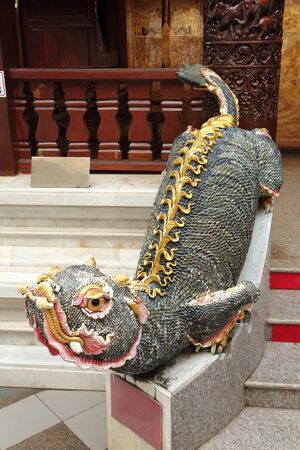 The Mom is a legendary animal. Is the vehicle of the god Pachunnathevabutra Which is the god of rain in Lanna The rat is shaped like a lion and cat.