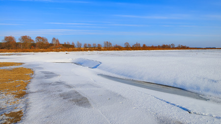 frozen river: The winter landscape. The bed of the frozen river.