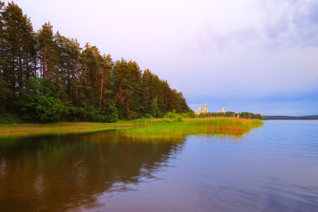 monastery nature: Early morning on lake Seliger. View of the monastery of the Nilo-Stolobenskaya Pustyn.