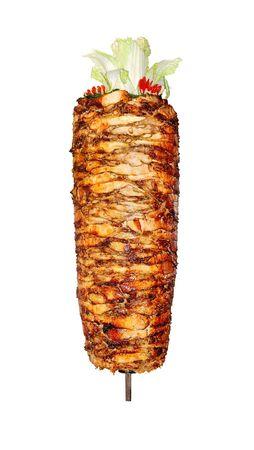 Kip voor shoarma, die wordt gebakken.  Stockfoto