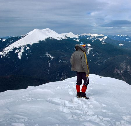 The man costs at top of mountain in the winter Stock Photo - 6763221