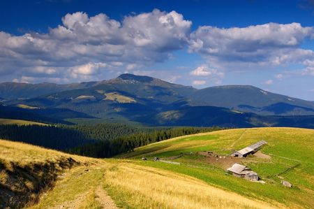 Summer landscape in mountains and a high-mountainous farm Stock Photo - 6763246