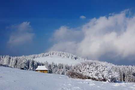 Winter landscape in mountains Carpathians, Ukraine and a valley with huts photo