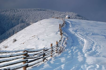 Winter landscape in mountains Carpathians, Ukraine and a valley with huts Stock Photo - 8071567