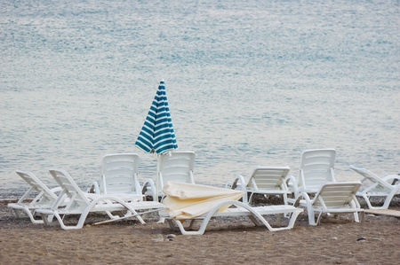 lounges: Sea coast with a beach, umbrellas and chaise lounges Stock Photo