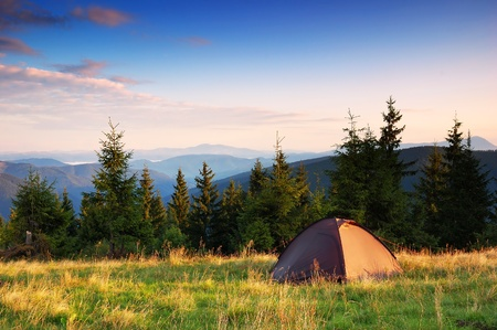 Morning landscape in mountains with tourist tent
