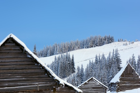Winter background with roofs of houses and slopes of mountains. Ukraine, Carpathians Stock Photo - 10910504