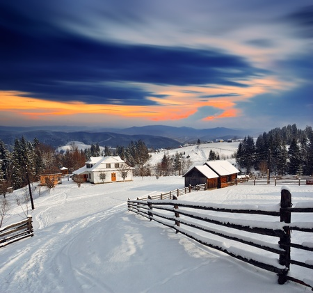 Winter landscape. Mountain village in the Ukrainian Carpathians. Stock Photo