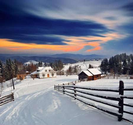 sunsets: Winter landscape. Mountain village in the Ukrainian Carpathians. Stock Photo