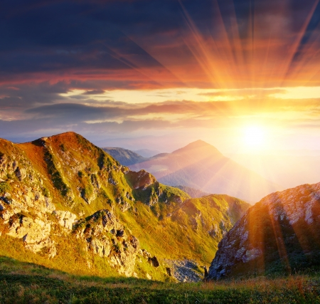 alp: The first beams of a rising sun shine mountains Carpathians, Ukraine