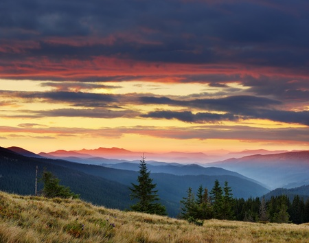 Landscape in the mountains with a cloudy sky colors the sunset. Ukraine, the Carpathian mountains photo