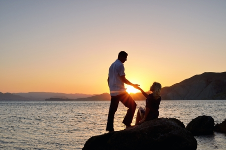 A man gives a woman photo