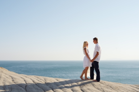 Young couple relaxing by the sea during the day photo