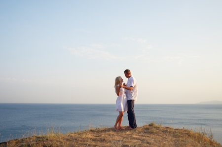 Young couple hugging on the beach photo