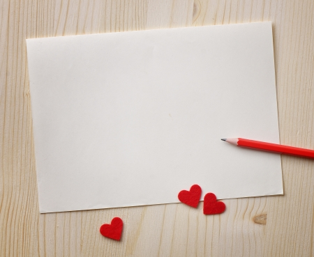 Love notes  Background for design with red hearts and red pencil on a sheet of paper