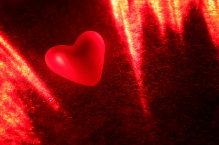 Red heart in the light of the laser  Background Valentine Stock Photo - 17045995