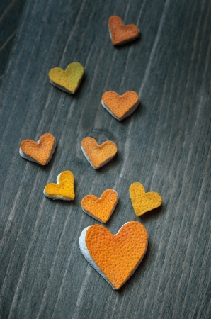 Hearts from the peel of citrus fruit on a wooden board Stock Photo - 17046007