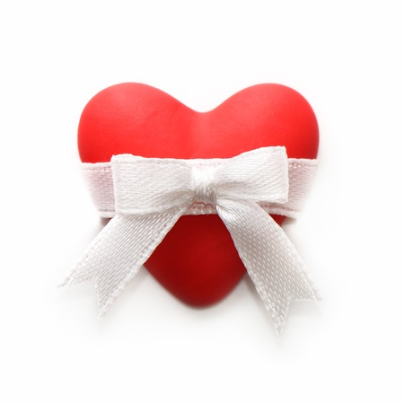 Red heart with a bow on a white background Stock Photo - 17093360