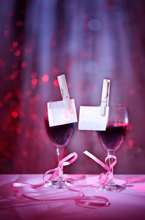 Two glasses of red wine associated with tape  Design on the theme of love Stock Photo - 17093357