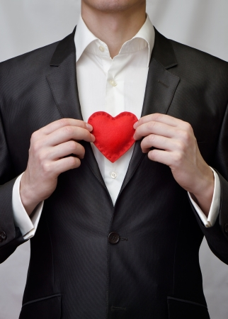 The guy holding a red decorative heart Stock Photo - 17098580