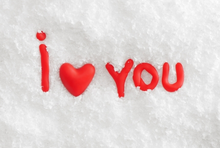 The phrase  I love you  in red letters on white snow photo