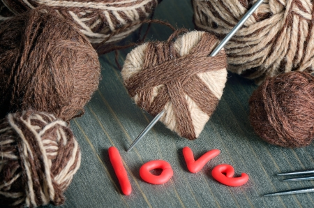 Still life with a heart of threads to Valentine photo