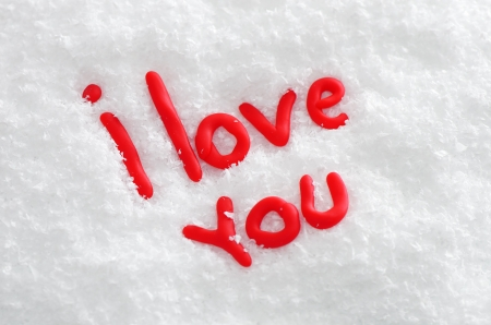 Declaration of love in red letters in the snow photo